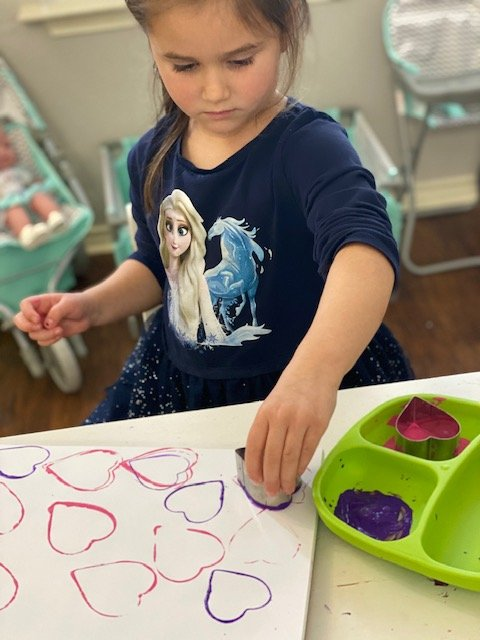 Heart stamping with paint and cookie cutters