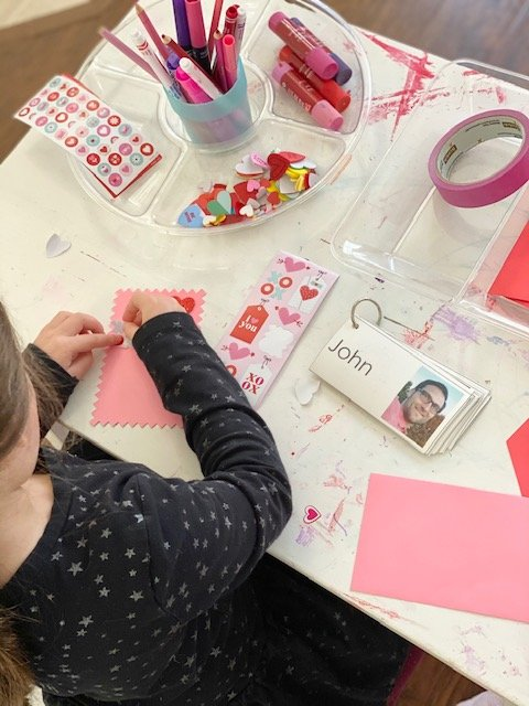 Charlotte creating valentines